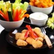 Chili cheese nuggets with raw vegetable - Foto de Stock  