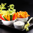 Raw vegetable and wedges with dip — Stock Photo