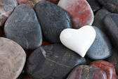 White heart surrounded by stones — Stock Photo