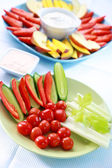 Raw vegetable and fruits with dip — Stock Photo