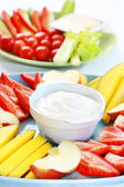 Raw fruits and vegetables with dip — Stock Photo