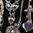 Stock Photo: Necklaces and accessories on black background