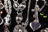 Necklaces and accessories on black background — Stock Photo