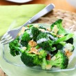 Broccoli salad with yogurt dressing and roasted almond - Stock Photo