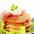 Small potato pancakes with salad — Stock Photo