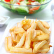 Baked potatoes with dip and vegetable salad - Stock Photo