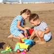 Kids playing on the beach — Stock Photo #9656118