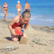 Child playing on the beach — Stock Photo #9656143
