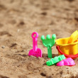 Stock Photo: Plastic toys for the kids on the beach