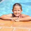Happy girl smiling at swimming pool — Stock Photo #9656356