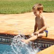 Happy boy having a fun at swimming pool - Stok fotoğraf