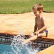 Happy boy having a fun at swimming pool - Stock Photo