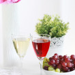 Two glasses of wine with grapes - Stock Photo
