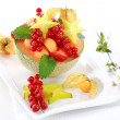 Fresh fruits served in melon bowl — Stock Photo