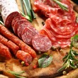 Italian ham and salami with herbs - Stock Photo