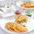 Potato pancakes with three dips - Stock Photo