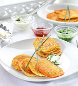 Potato pancakes with three dips — Stock Photo