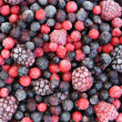 Close up of frozen mixed fruit  - berries - red currant, cranberry, raspber - Stock Photo