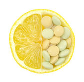 Close up of lemon and pills isolated – vitamin concept — Stock Photo