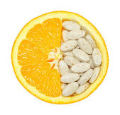 Close up of orange and pills isolated - vitamin concept — Stock Photo