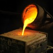 Foundry - molten metal poured from ladle into mould - lost wax casting — Stock Photo