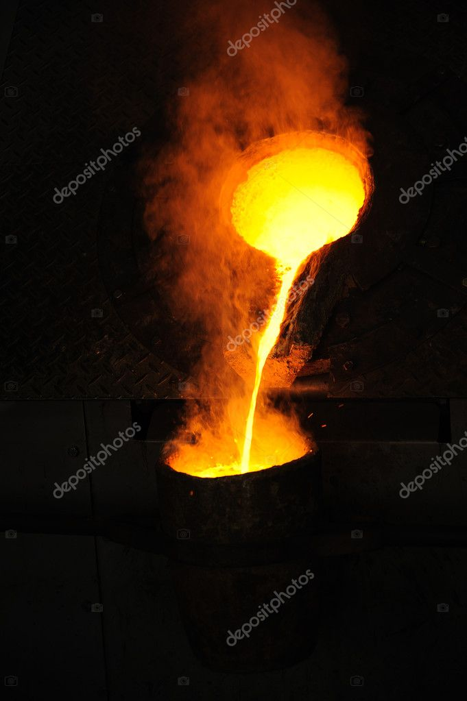 Foundry - molten metal poured from ladle for casting  Stock Photo #9457028