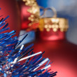 Tinsel and Christmas baubel — Stock Photo