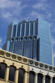 Office tower with old buildings. — Stock Photo