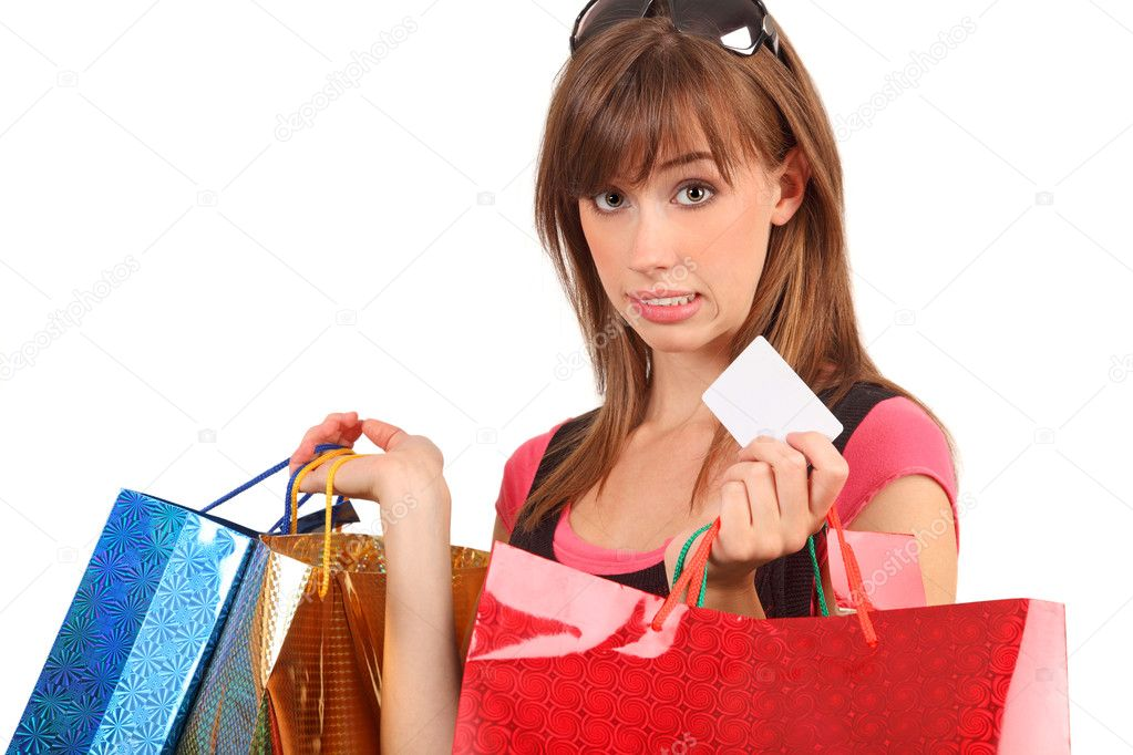 An attractive woman with colorful shopping bags and blank white credit-card for overlay. — Stock Photo #10005366