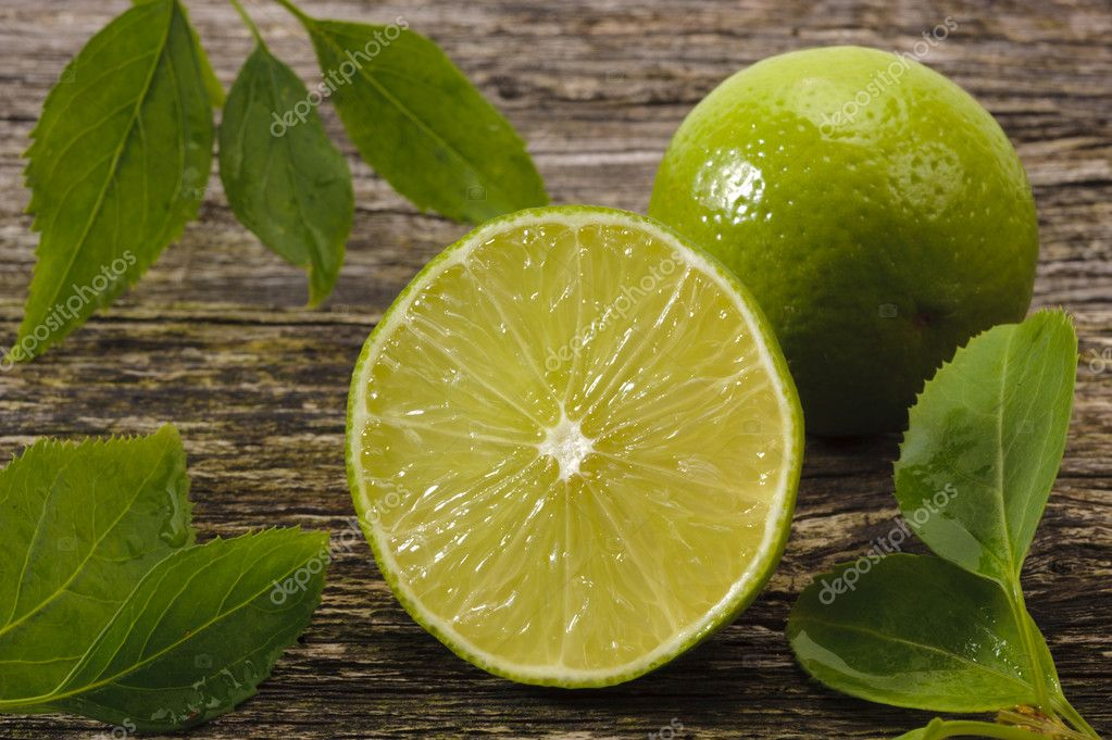 Half lime on wood — Stock Photo #8419072