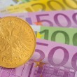Stock Photo: Golden coin over euro