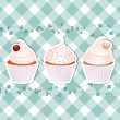 Cupcakes on blue gingham — Stock Vector