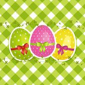 Easter eggs on a green gingham border — Stock Vector