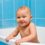 Happy baby in bathroom — Stock Photo #10263058