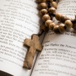 Wooden rosary on the open Bible - Stok fotoraf