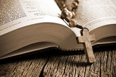 Wooden rosary on the open Bible — Stock Photo