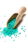 Green bath salt with wooden scoop — Stock Photo