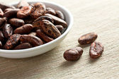 Cocoa beans in bowl — Stock Photo