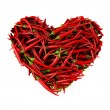 Heart made of Chili Pepper. - Stock Photo