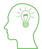 Human head with green ligh bulb — Stock Photo