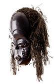 Maschera tribale vista laterale su sfondo bianco — Foto Stock