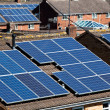 Solar Panels on many residential roofs — Stock Photo #9856764