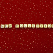 "Words ""new collection"" of beads on a red velvet with sequins — Stock Photo"