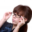 Attractive woman holding her eyeglasses — Stock Photo #7989219
