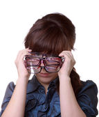 Attractive woman holding her eyeglasses — Stock Photo