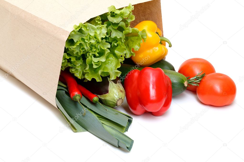 Grocery bag full of vegetables isolated on white background — Stock Photo #8627001