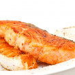 Fried salmon fillets with sauce - Stock Photo