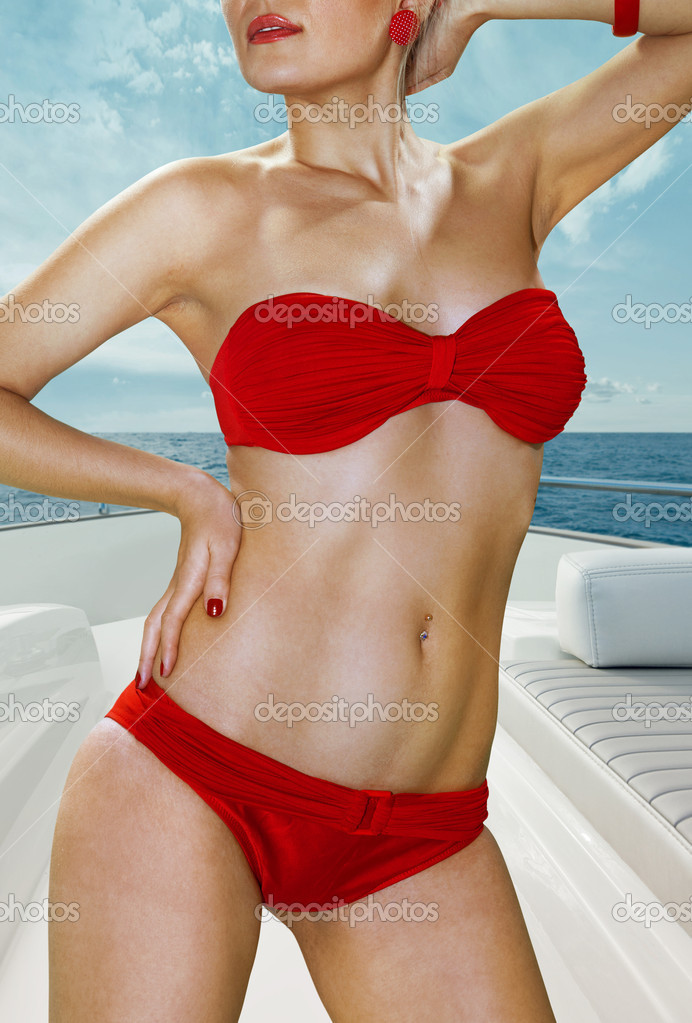 Blonde woman in red underwear on deck of yacht — Stock Photo #10177129