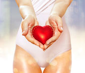 Red heart on hands — Stock Photo
