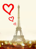 Hearts in front of famous Eiffel Tower — Stock Photo